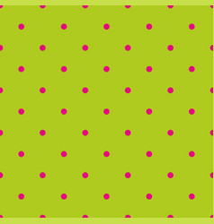 Seamless pattern with pink polka dots on a green vector
