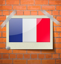 Flags Frence scotch taped to a red brick wall vector image