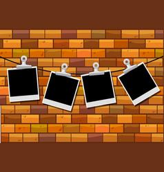 Photo frames hanging on brick wall vector
