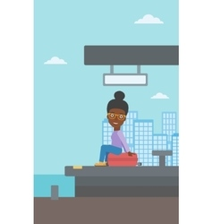 Woman sitting on suitcase at the train station vector