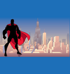 superhero standing tall in city silhouette vector image