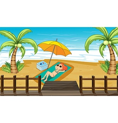 A girl sunbathing at the shore vector image vector image