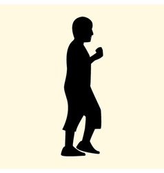 A silhouette of a little boy is walking and eating vector