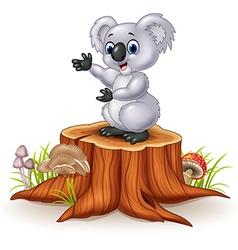 Cartoon koala presenting on tree stump vector