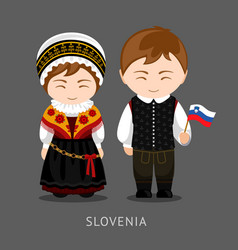 slovenes in national dress with a flag vector image