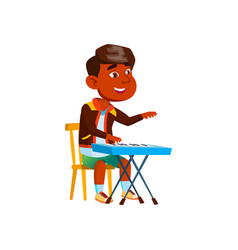 Indian boy playing on piano musical instrument vector