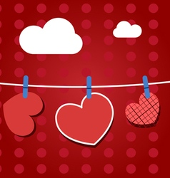 Paper hearts hanging from a rope on red wallpaper vector image
