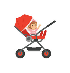 Adorable little girl sitting in a red baby vector