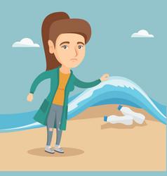 Woman showing plastic bottles under sea water vector