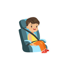 cute little boy sitting in blue car seat safety vector image