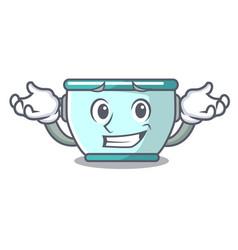 Grinning steel pot character cartoon vector