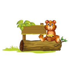 A bear sitting on a trunk vector image