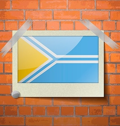 Flags Tuva scotch taped to a red brick wall vector