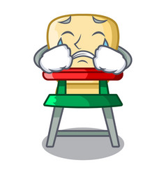 crying cartoon baby sitting in the highchair vector image