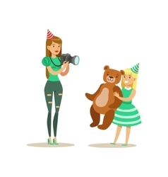 Woman Taking Pictures With Girl And Teddy Bear vector image