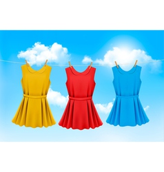 Set of colored dresses hanging on a clothesline on vector image
