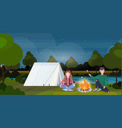 couple hikers roasting marshmallow candies on vector image
