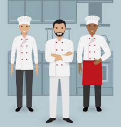 Chef and two cook in uniform standing together vector