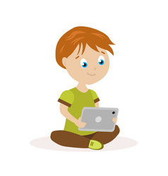 boy sitting on the floor with a tablet in hands vector image vector image