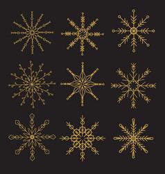 geometric golden snowflakes on black background vector image
