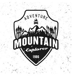 Mountains and forest black badge on white vector