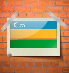 Flags Karakalpakstan scotch taped to a red brick vector
