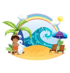A boy standing beside his surfing board at the vector image vector image
