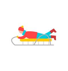 boy lying on sled having fun vector image