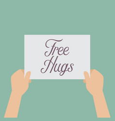 Hands holding a free hugs sign vector