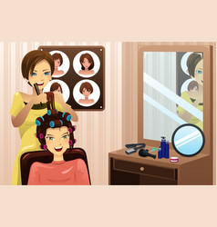 Hairstylist working in a salon vector