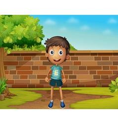 Boy standing in yard vector