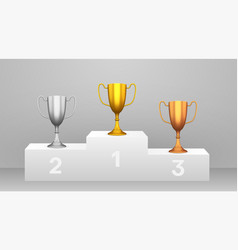 podium with golden silver and bronze cups vector image