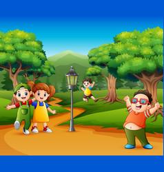 Happy kids playing in the garden vector