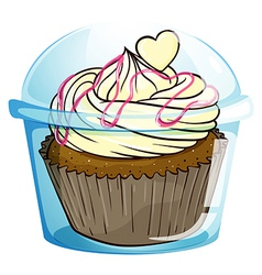 A cupcake inside the disposable container vector image