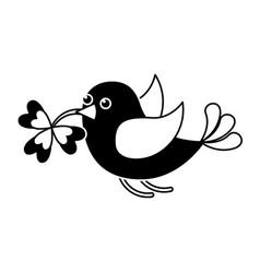 Black and white bird flying with clover in beak vector