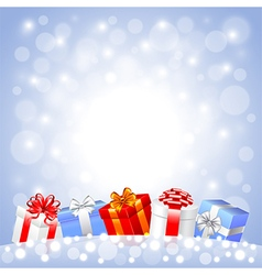 Christmas gifts in the snow on white background vector