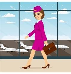 Stewardess with briefcase walking vector