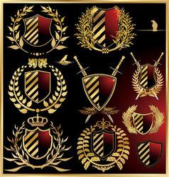 Set of the black shields with golden laurel vector
