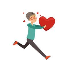 happy teen boy running with red heart happy vector image vector image