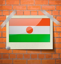 Flags Niger scotch taped to a red brick wall vector