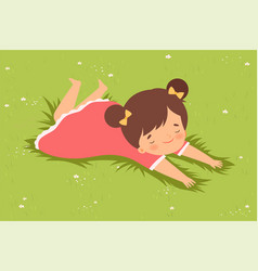Lovely girl lying down on green lawn on her vector