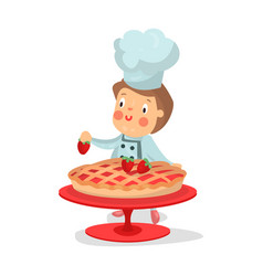 Cute cartoon little boy chef character baking vector