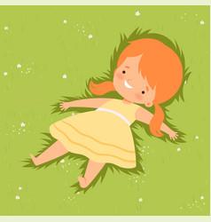 Cute girl lying down on green lawn lovely kid vector