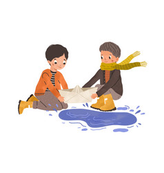 Kids playing with paper boat and puddle in autumn vector