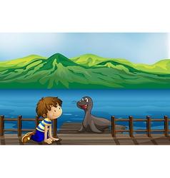 A boy and a sea lion vector