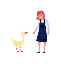 girl standing next to goose female farmer taking vector image