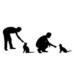 silhouettes people feeding cats vector image