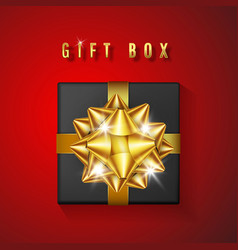 realistic black gift box with golden bow and vector image