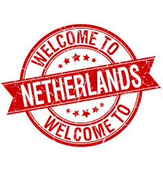 Welcome to netherlands red round ribbon stamp vector