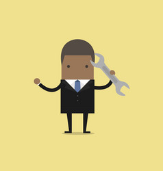 african businessman with a spanner vector image